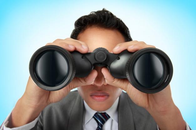 business-man-looking-through-binocular_8595-14140