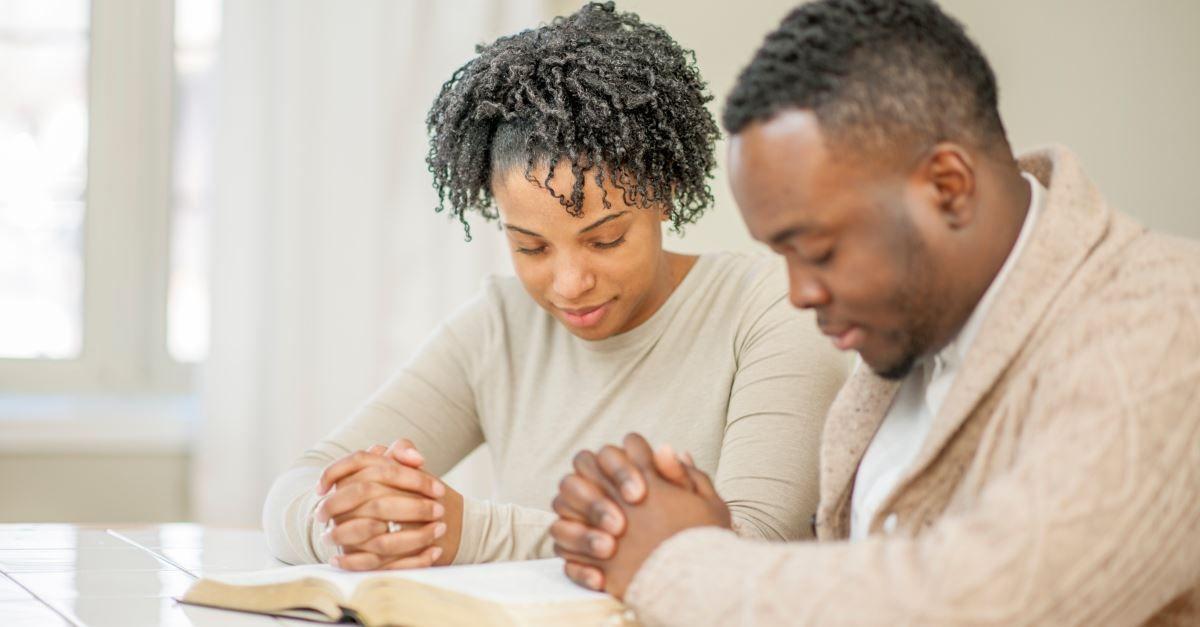 husband wife praying
