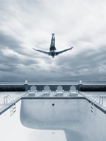 man-diving-into-an-empty-pool_u-l-p3j1pi0